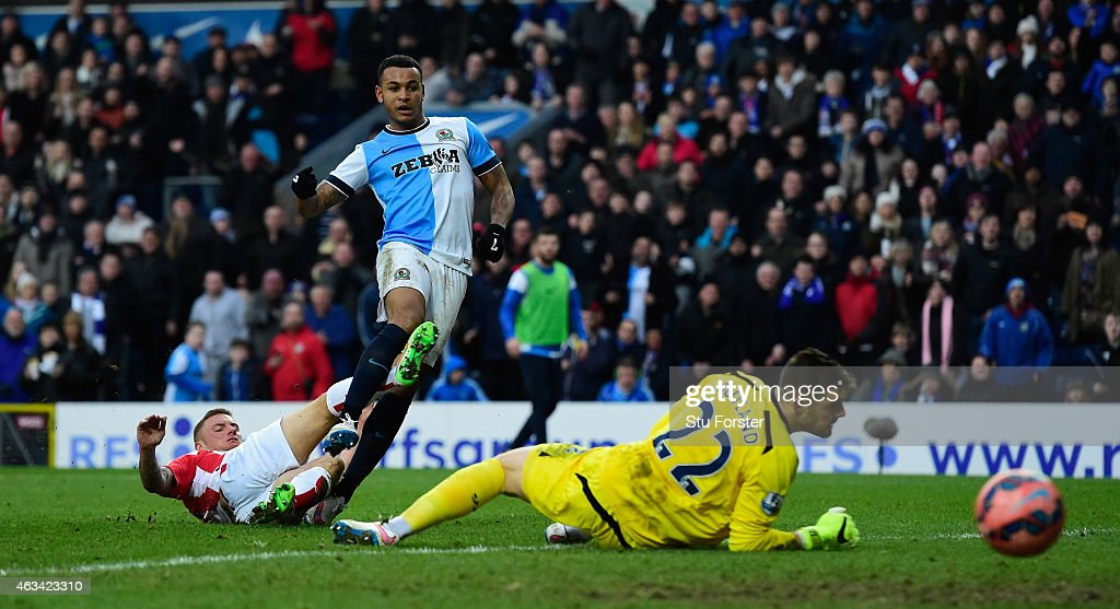 Stoke goalkeeper Jack Butland is beaten by a shot from Josh King of Blackburn to score their fourth goal and complete his hat trick during the FA Cup Fifth round match between Blackburn Rovers and Stoke City at Ewood park on February 14, 2015 in Blackburn, England.