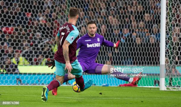 Stoke goalkeeper Jack Butland saves a shot from West Ham United's Marko Arnautovic during the Premier League match between Stoke City and West Ham...