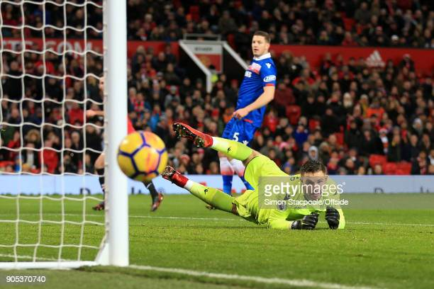 Stoke goalkeeper Jack Butland watches the ball drift wide during the Premier League match between Manchester United and Stoke City at Old Trafford on...
