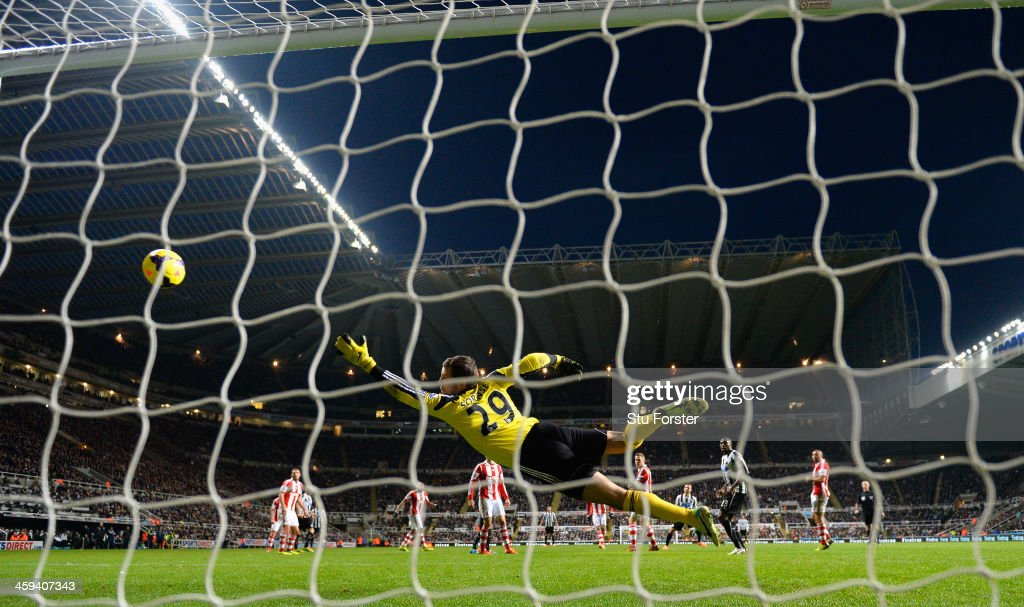 Stoke goalkeeper Thomas Sorensen dives in vain as Yohan Cabaye scores the fourth goal during the Barclays Premier League match between Newcastle United and Stoke City at St James' Park on December 26, 2013 in Newcastle upon Tyne, England.