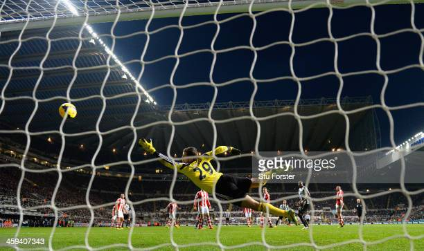 Stoke goalkeeper Thomas Sorensen dives in vain as Yohan Cabaye scores the fourth goal during the Barclays Premier League match between Newcastle...
