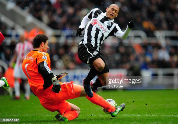 Stoke keeper Asmir Bergovic challenges Newcastle forward Yoan Gouffran during the Barclays Premier League match between Newcastle United and Stoke...