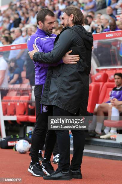 Stoke manager Nathan Jones greets Norwich manager Daniel Farke ahead of the Sky Bet Championship match between Stoke City and Norwich City at the...