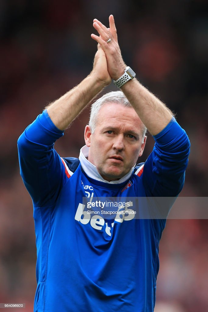 Stoke manager Paul Lambert applauds the support at the end of the Premier League match between Liverpool and Stoke City at Anfield on April 28, 2018 in Liverpool, England.
