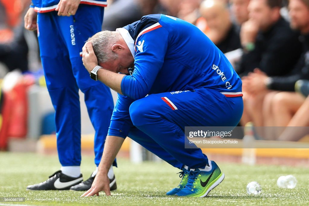 Stoke manager Paul Lambert looks dejected during the Premier League match between Liverpool and Stoke City at Anfield on April 28, 2018 in Liverpool, England.