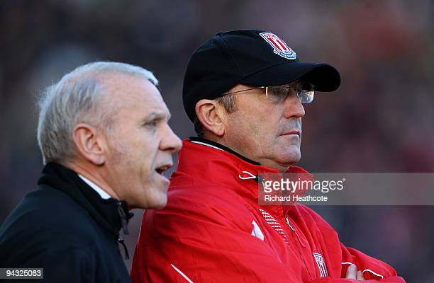 Stoke Manager Tony Pulis and assistant Peter Reid watch on during the Barclays Premier League match between Stoke City and Wigan Athletic at the...