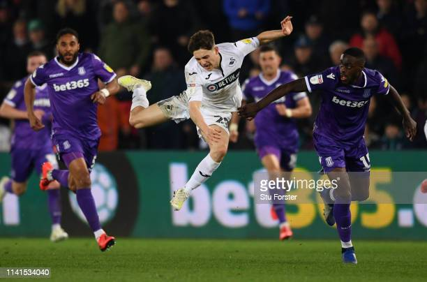 Stoke player Bruno Martins Indi is sent off for this challenge on Daniel James of Swansea during the Sky Bet Championship match between Swansea City...