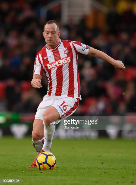 Stoke player Charlie Adam in action during the Premier League match between Stoke City and Newcastle United at Bet365 Stadium on January 1 2018 in...
