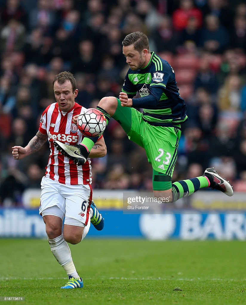 Stoke player Glenn Whelan (l) challenges Gylfi Sigurdsson of Swansea during the Barclays Premier League match between Stoke City and Swansea City at Britannia Stadium on April 2, 2016 in Stoke on Trent, England.