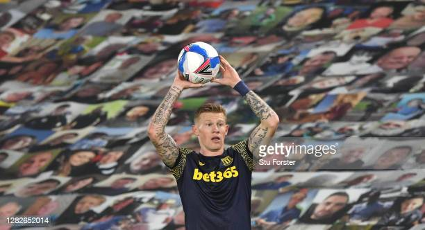 Stoke player James McClean prepares to take a throw in infront of a background of fans pictures during the Sky Bet Championship match between Swansea...