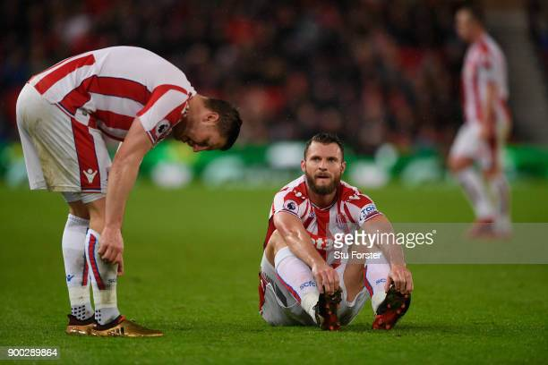 Stoke players Kevin Wimmer and Erik Pieters react during the Premier League match between Stoke City and Newcastle United at Bet365 Stadium on...