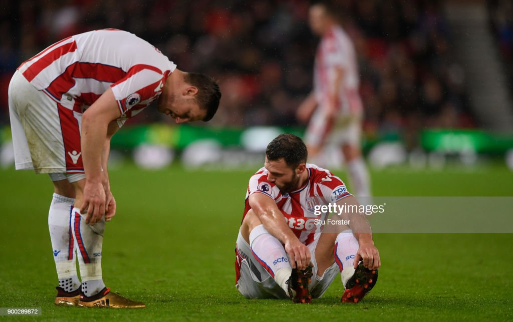 Stoke players Kevin Wimmer (l) and Erik Pieters react during the Premier League match between Stoke City and Newcastle United at Bet365 Stadium on January 1, 2018 in Stoke on Trent, England.