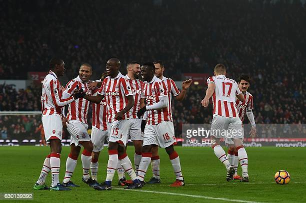 Stoke players mob Stoke City's Welsh midfielder Joe Allen after he scored his team's second goal during the English Premier League football match...