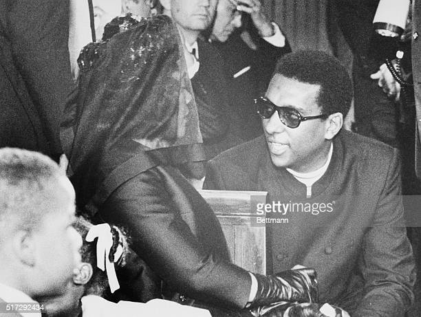 Stokely Carmichael talks with the widow of slain civil rights leader Dr Martin Luther King Jr at funeral services in Dr King's Ebenezer Baptist Church