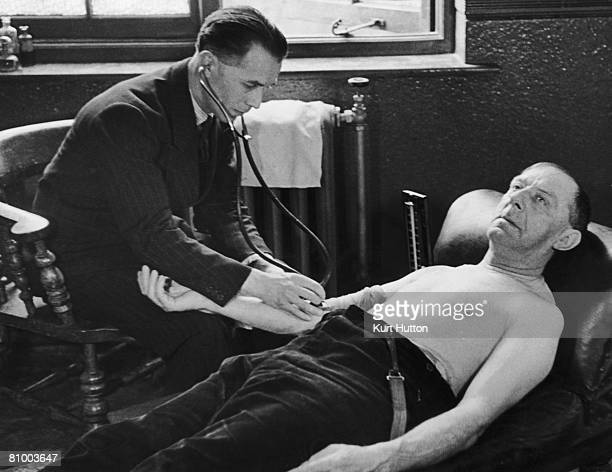 Stoker Alex Purslow has his blood pressure tested at a clinic in Wales 27th April 1946 The test is free as will be any resulting care Original...
