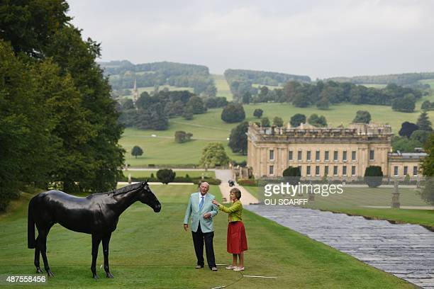 Stoker Cavendish Duke of Devonshire and Amanda Duchess of Devonshire look at a sculpture by British artist Mark Wallinger entitled 'The Black Horse'...