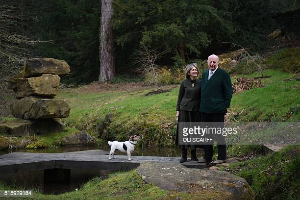 Stoker Cavendish, Duke of Devonshire and his wife Amanda, Duchess of Devonshire, pose for a photograph with their dog Max, adjacent to the...