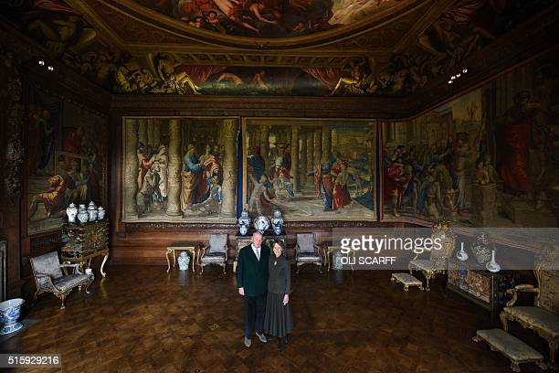 Stoker Cavendish Duke of Devonshire and his wife Amanda Duchess of Devonshire pose for a photograph in the State Drawing Room of Chatsworth House in...