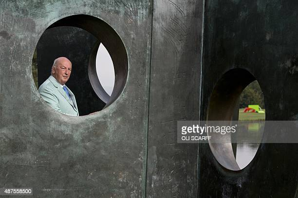 Stoker Cavendish Duke of Devonshire poses by a sculpture by British artist Barbara Hepworth entitled 'Three Obliques ' that features in the 'Beyond...