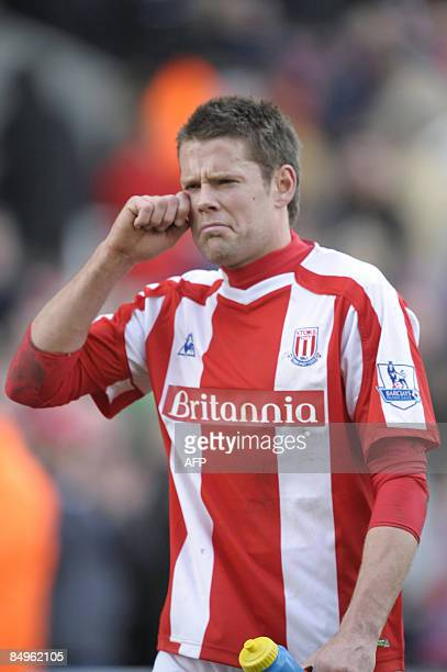 Stoke's James Beattie makes a face at supporters during his team's English Premiership football match against Portsmouth at the Britannia Stadium...