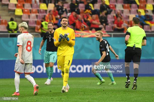 Stole Dimitrievski of North Macedonia looks dejected after conceding their side's third goal scored by Marko Arnautovic of Austria during the UEFA...