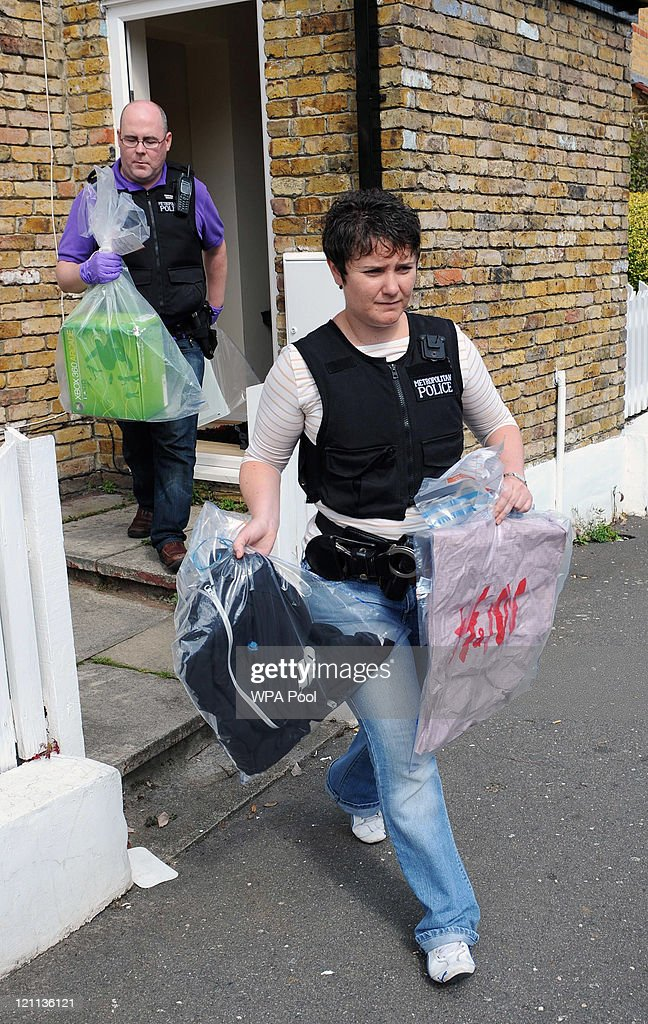 Stolen goods and items of clothing worn by a suspect in connection with recent rioting and looting in the capital are removed as evidence by Metropolitan Police officers during an early morning raid at an address in SW12 on August 14, 2011 in south London, England. As part of 'Operation Withern', Metropolitan police officers carried out a series of raids before 0730hrs on eight addresses in south London and recovered evidence for six suspects in connection with the recent outbreaks of rioting and looting throughout London.