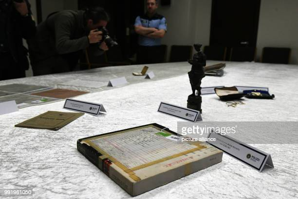 Stolen items of the Beatles musician John Lennon are on display during a press conference at the German police department headquarters in Berlin,...