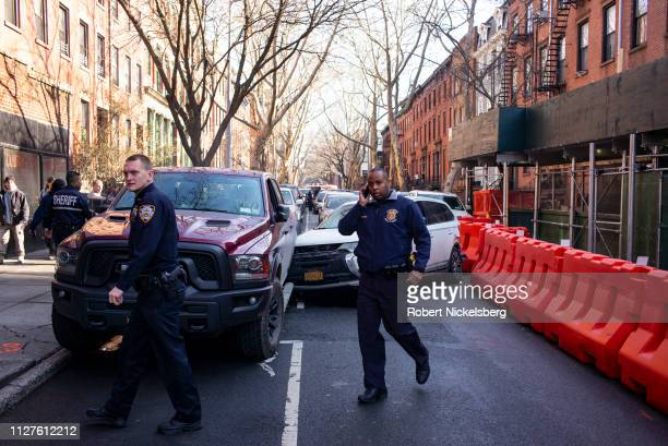 A stolen Mitsubishi SUV lies crashed on a street of Brooklyn New York on February 5 2019 The white SUV was being chased by several NYPD cars when it...