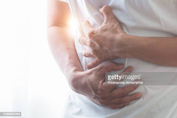 stomachache,businessman stomachache - appendicitis stock photos and pictures