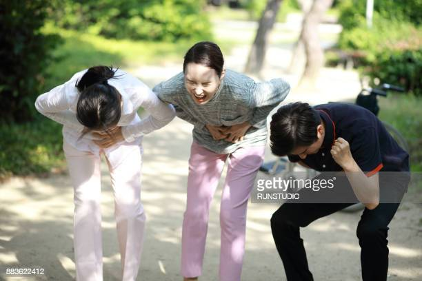 Stomachache.People holding stomach with pained expression