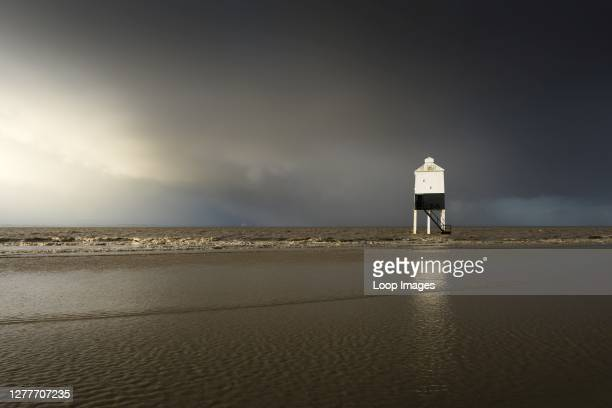Stomy sky over the low lighthouse on the beach at Burnham-on-Sea in Somerset.