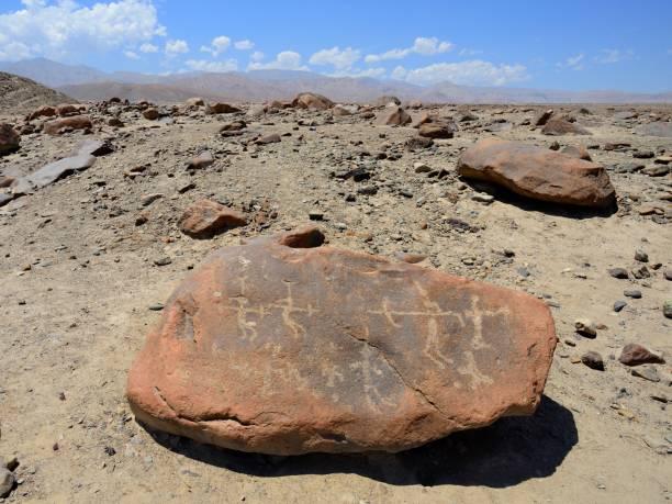 Stone Age stone carvings on a rock, petroglyphs of Miculla, near Tacna, Tacna province, Peru
