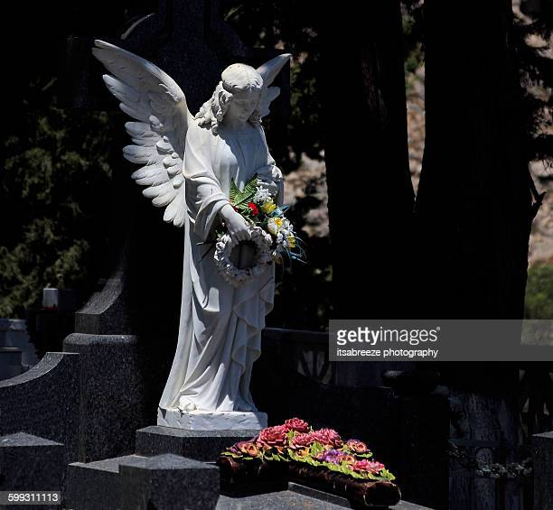 stone angel over grave - rest in peace stock photos and pictures