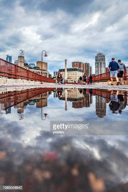 Stone Arch Bridge in Minneapolis reflected in puddle