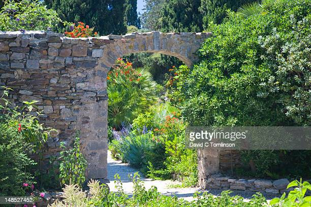 stone arch in gardens of parc castel ste-claire. - claire castel stock pictures, royalty-free photos & images