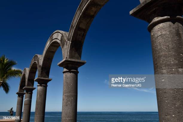 Stone arches at Los Arcos Amphitheatre on the Malecon of Puerto Vallarta Mexico