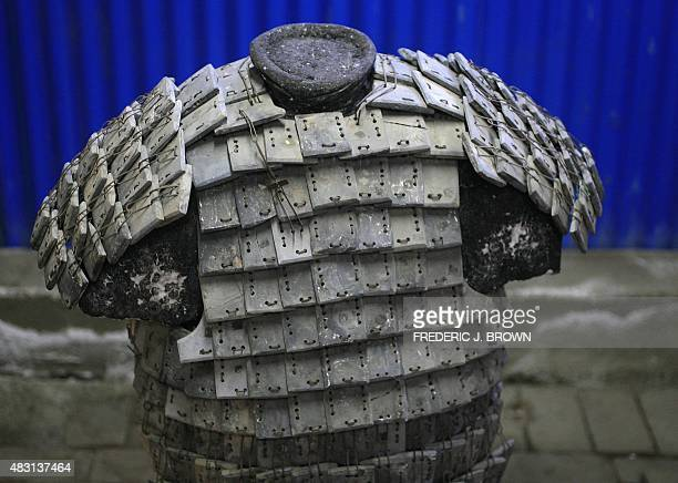 Stone armour plates stiched together from the countless stone armour plates found in a pit where Duan Qingbo head of the excavation team for the...