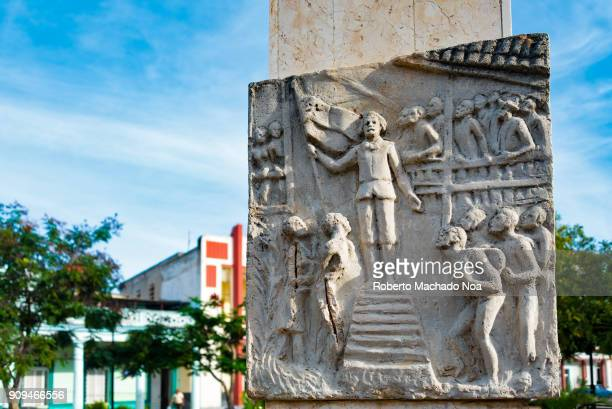 Stone basrelief artwork related to the Cuban Independence Wars The piece is seen on one of the many parks in the city of Holguin