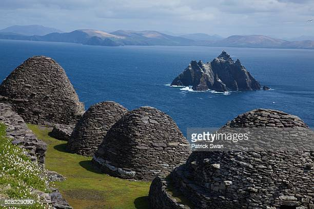 Stone 'beehive' Monk Huts (Clochans) With A View Of Skellig Beag