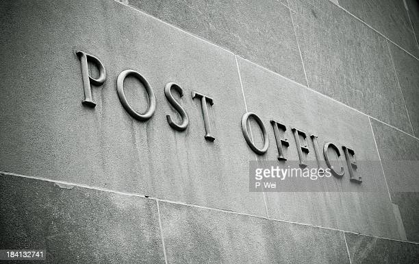 Stone blocks with lettering reading Post Office