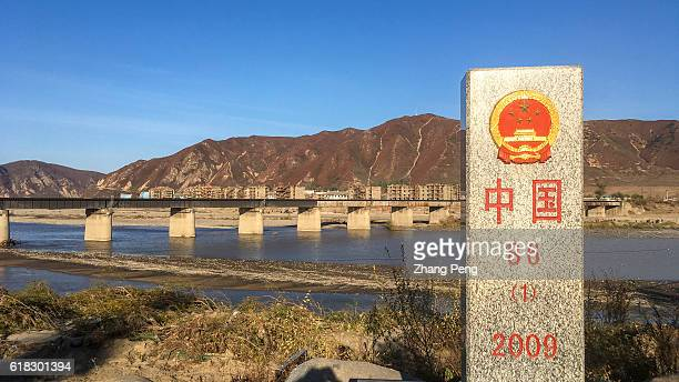 Stone boundary marker at China's side The opposite over the Tumen River is Namyang town of North Korea Namyang is the hometown of North Korea's...