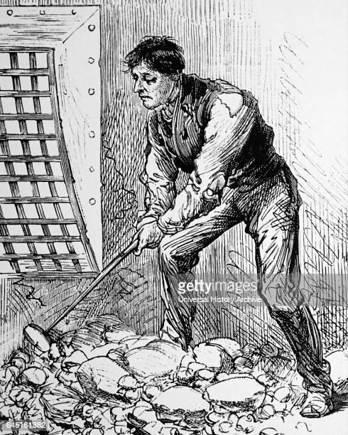 Stone breaking in the casual ward of a typical London workhouse The stone had to be small enough to pass through the metal 1895