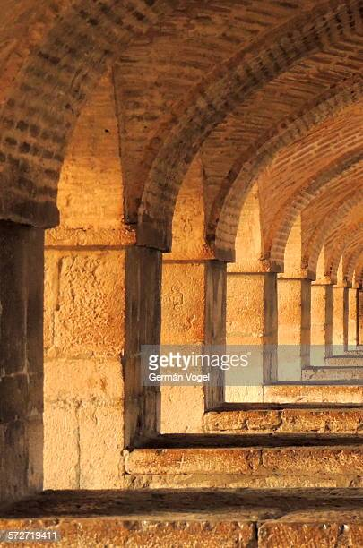 stone & brick columns & arches row under bridge - ハージュ橋 ストックフォトと画像