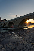stone bridge skyline regensburg with setting