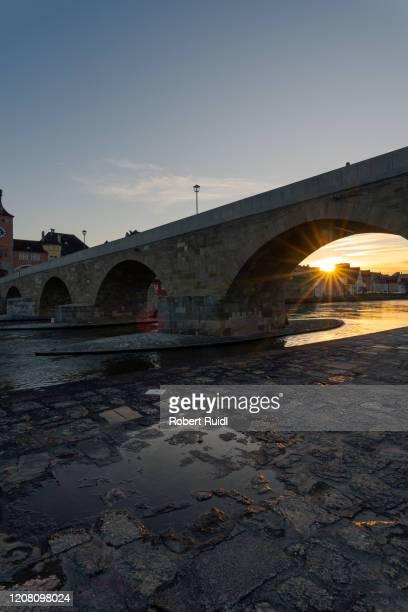 stone bridge skyline regensburg with setting