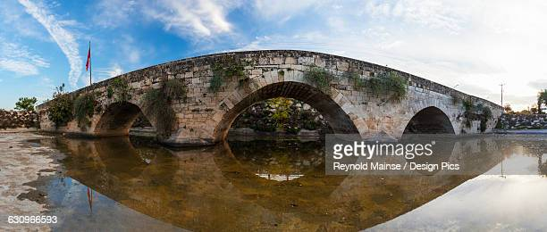 stone bridge at the entrance to tarsus on the ankara-adana road - 6th century bc stock photos and pictures