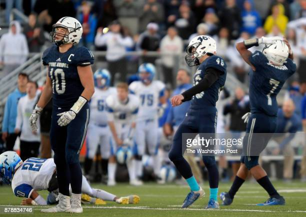 Stone Bridge kicker Haydon Baron center and holder Tyrese Johnson right react to their late 4th quarter missed field goal that would have won the...