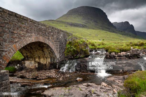 stone bridge over russel burn mountain stream of bealach na ba road mountain pass on applecross peninsula scottish highlands scotland uk - wester ross stock pictures, royalty-free photos & images