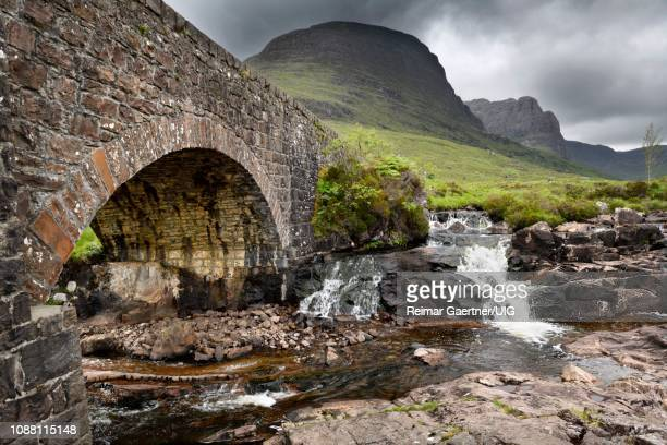 stone bridge over russel burn river of bealach na ba road mountain pass on applecross peninsula scottish highlands scotland uk - wester ross stock pictures, royalty-free photos & images