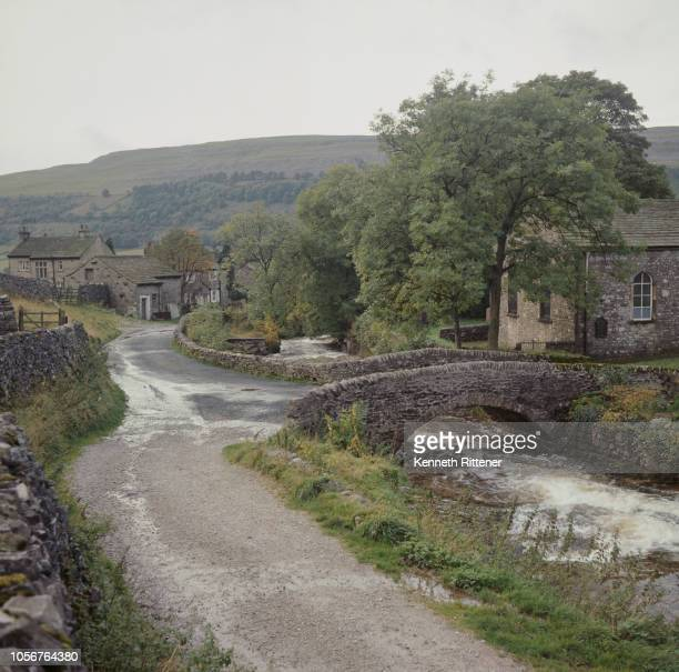 Stone bridge over the River Wharfe in the village of Kettlewell in Upper Wharfedale, North Yorkshire, 23rd October 1967.